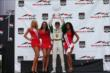 Mike Conway raises his winner's trophy with the Toronto Sun Grid Girls after Race 2 of the Honda Indy Toronto -- Photo by: Chris Jones
