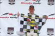 Mike Conway with the Sunoco checkered flag after winning Race 2 of the Honda Indy Toronto -- Photo by: Chris Jones