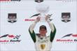Mike Conway raises his winner's trophy after winning Race 2 of the Honda Indy Toronto -- Photo by: Chris Jones
