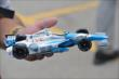 A fan holds a model car of James Hinchcliffe at the Honda Indy Toronto -- Photo by: Chris Owens
