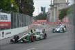 Sebastien Bourdais and James Hinchcliffe enter Turn 2 during Race 2 of the Honda Indy Toronto -- Photo by: Chris Owens