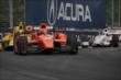 Simon Pagenaud leads a group into Turn 5 during Race 2 of the Honda Indy Toronto -- Photo by: Joe Skibinski
