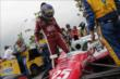 Marco Andretti climbs into his machine before Race 2 of the Honda Indy Toronto -- Photo by: Joe Skibinski