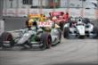 Sebastien Bourdais and Helio Castroneves lead the field into Turn 3 during Race 1 of the Honda Indy Toronto -- Photo by: Shawn Gritzmacher