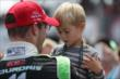 Sebastien Bourdais with his son after winning Race 1 of the Honda Indy Toronto -- Photo by: Shawn Gritzmacher