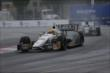 Mike Conway and Sebatien Bourdais enter Turn 10 during Race 2 of the Honda Indy Toronto -- Photo by: Shawn Gritzmacher