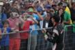 Will Power sprays champagne into the crowd around Victory Circle following Race 2 of the Honda Indy Toronto -- Photo by: Shawn Gritzmacher
